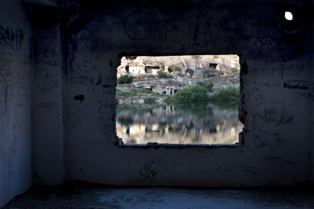 Savasan Village is partially submerged in 1999 under the water behind the dam on the Euphrates at Birecik. There are two families still living in the old village.