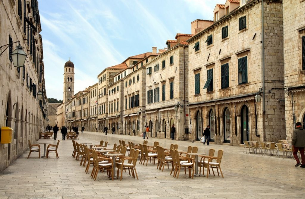 a-walk-through-the-old-dubrovnik-city-streets-strada-of-dubrovnik-the-strada-is-the-main-shopping-street-and-gathering-area-in-the-city-of-dubrovnik-in-croatia-main-street-by-early-morning-431-4875